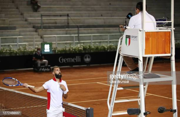 Benoit Paire of France reacts to the umpire in the second set of his round one match against Jannik Sinner of Italy during day one of the...