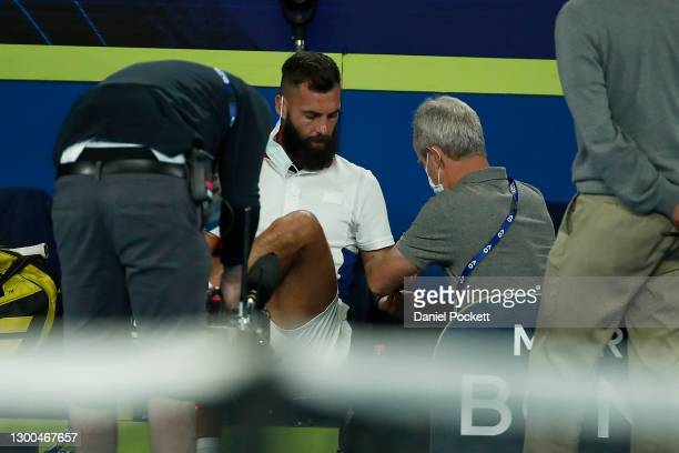 Benoit Paire of France receives medical attention in his group C singles match against Dominic Thiem of Austria during day four of the 2021 ATP Cup...