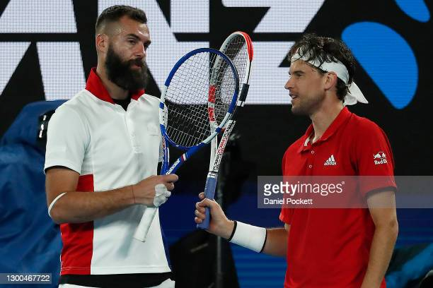 Benoit Paire of France retires with injury and congratulates Dominic Thiem after their group C singles match against Dominic Thiem of Austria during...