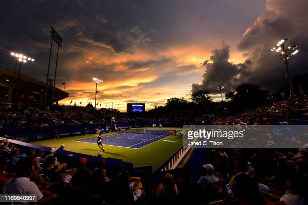 Benoit Paire of France returns a shot from Steve Johnson during their semifinals match on day seven of the Winston-Salem Open at Wake Forest...