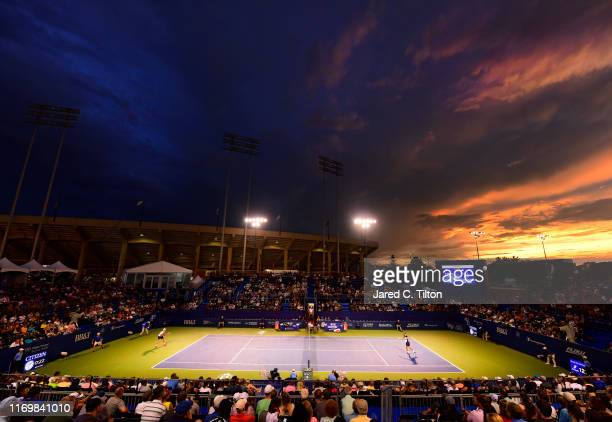 Benoit Paire of France returns a shot from Steve Johnson during their semifinals match on day seven of the WinstonSalem Open at Wake Forest...