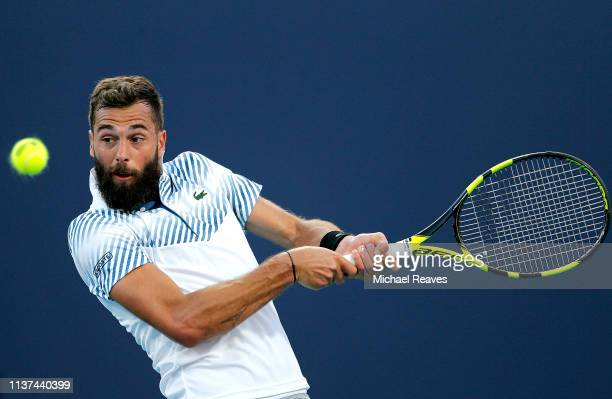 Benoit Paire of France returns a shot to Feliciano Lopez of Spain during Day 4 of the Miami Open Presented by Itau at Hard Rock Stadium on March 21...