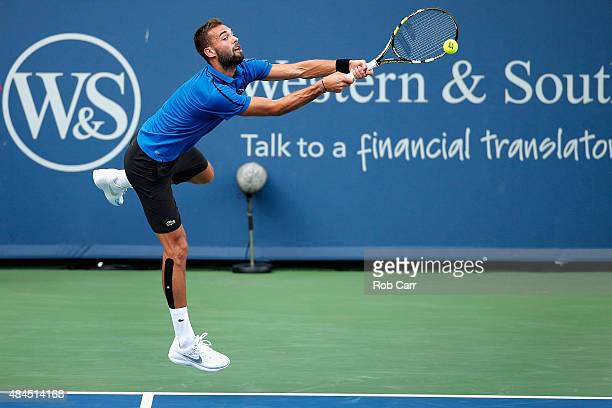 Benoit Paire of France returns a shot to Novak Djokovic of Serbia during the Western Southern Open at the Linder Family Tennis Center on August 19...