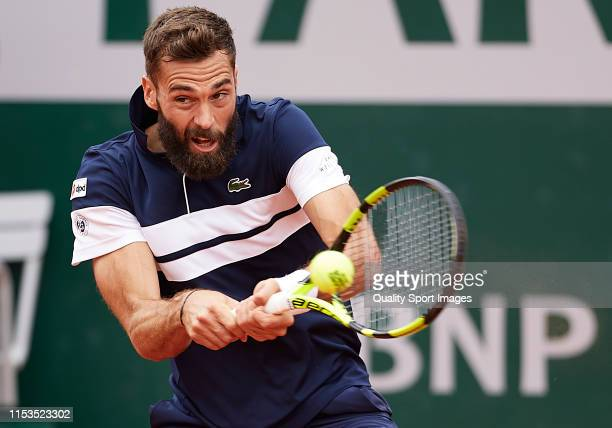 Benoit Paire of France returns the ball in his mens singles fourth round match against Kei Nishikori of Japan during Day nine of the 2019 French Open...