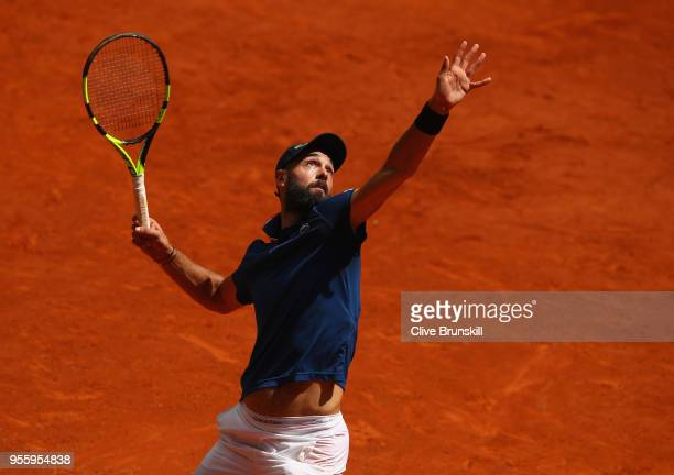 Benoit Paire of France serves against Denis Shapovalov of Canada in their second round match during day four of the Mutua Madrid Open tennis...