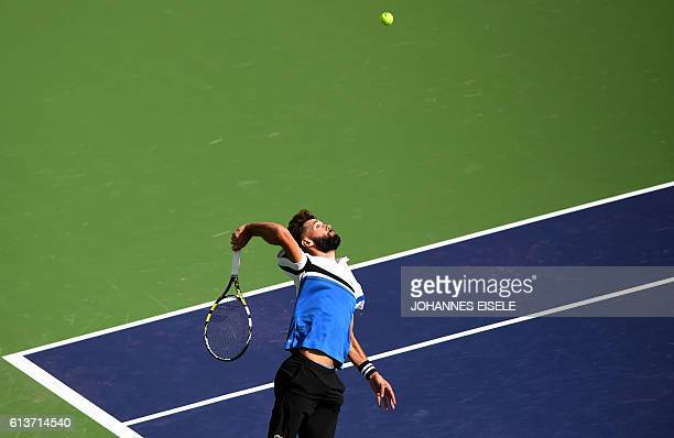Benoit Paire of France serves against Joao Sousa of Portugal during their first round men's singles match at the Shanghai Masters tennis tournament...