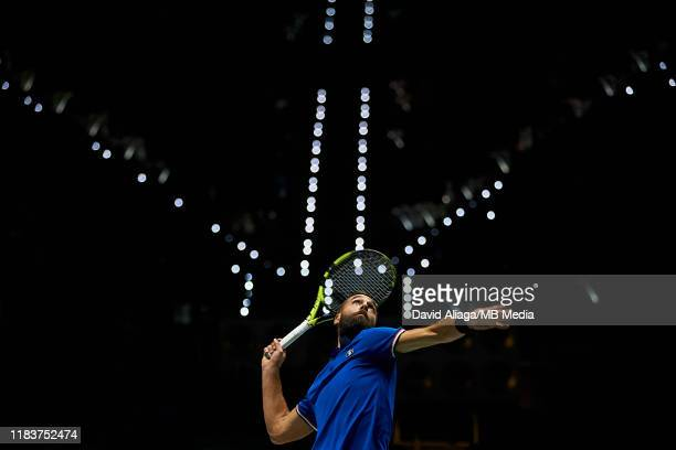 Benoit Paire of France serves during his match against Novak Djokovic of Serbia during Day Four of the 2019 Davis Cup at La Caja Magica on November...