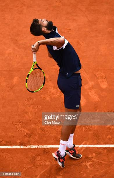 Benoit Paire of France serves during his mens singles fourth round match against Kei Nishikori of Japan during Day nine of the 2019 French Open at...