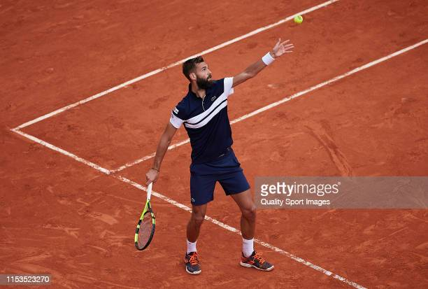 Benoit Paire of France serves in his mens singles fourth round match against Kei Nishikori of Japan during Day nine of the 2019 French Open at Roland...