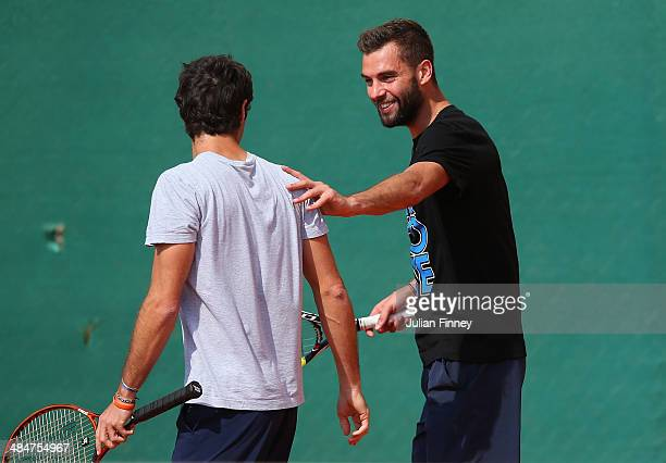 Benoit Paire of France shares a joke during day two of the ATP Monte Carlo Rolex Masters Tennis at MonteCarlo Sporting Club on April 14 2014 in...