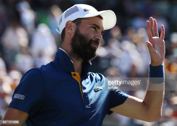 Benoit Paire of France waves to the crowd after defeating Novak Djokovic of Serbia during Day 5 of the Miami Open at the Crandon Park Tennis Center...