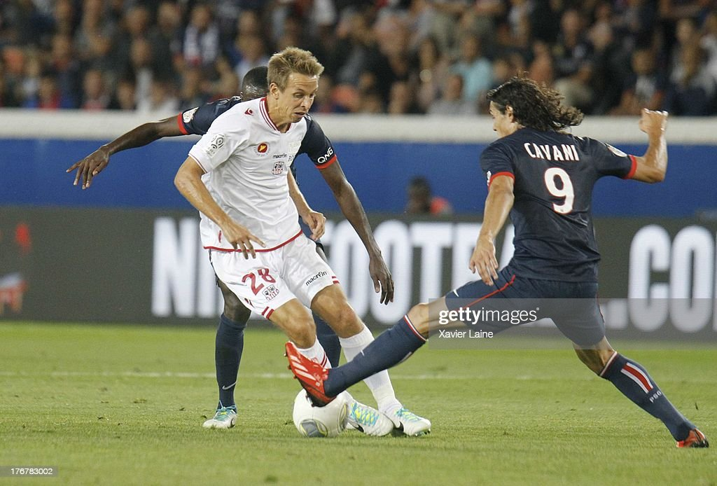 Benoit Pedretti of Ajaccio AC and Edinson Cavani of Paris Saint-Germain in action during the French League 1 between Paris Saint-Germain FC and AC Ajaccio, at Parc des Princes on August 18, 2013 in Paris, France.