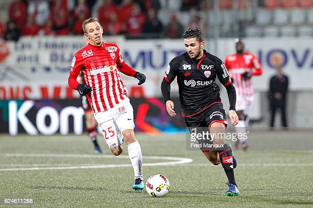 Benoit Pedretti of Nancy and Mehdi Abeid of Dijon during the Ligue 1 match between As Nancy Lorraine and Dijon FCO at Stade Marcel Picot on November...