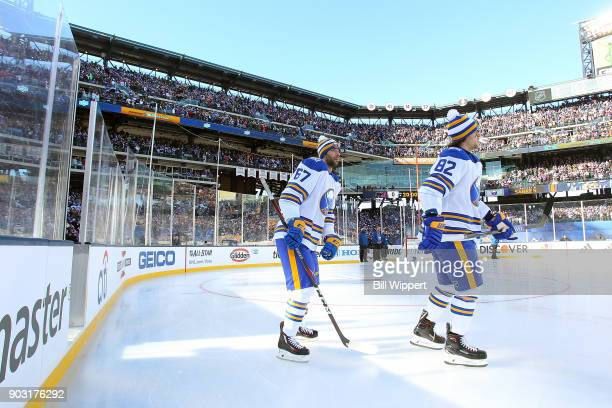 Benoit Pouliot and Nathan Beaulieu of the Buffalo Sabres prepare to play the New York Rangers during the 2018 Bridgestone NHL Winter Classic at Citi...