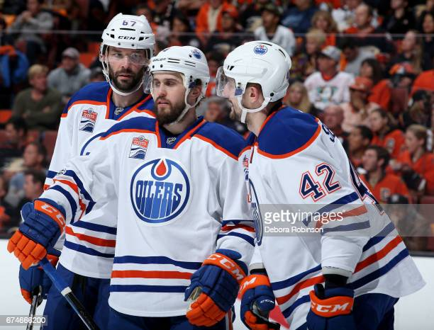 Benoit Pouliot Kris Russell and Anton Slepyshev of the Edmonton Oilers talk during the game against the Anaheim Ducks in Game Two of the Western...