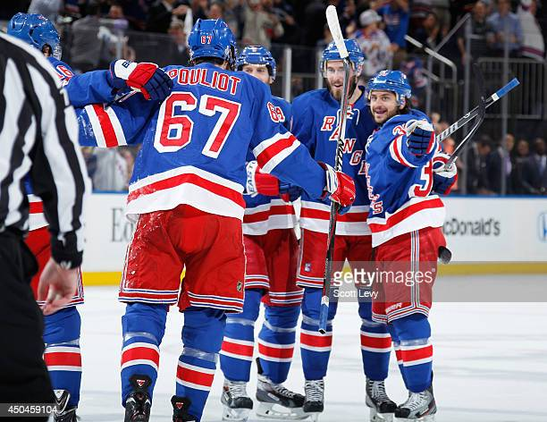 Benoit Pouliot Mats Zuccarello John Moore and Dan Girardi of the New York Rangers celebrate after a first period goal against the Los Angeles Kings...
