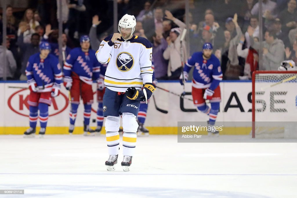 Benoit Pouliot #67 of the Buffalo Sabres reacts after a goal by the New York Rangers in the third period during their game at Madison Square Garden on January 18, 2018 in New York City.