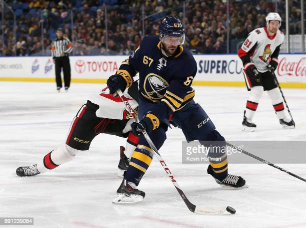 Benoit Pouliot of the Buffalo Sabres scores a goal on this back hand shot during the second period against the Ottawa Senators at the KeyBank Center...
