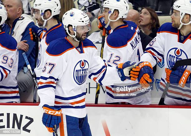 Benoit Pouliot of the Edmonton Oilers celebrates after scoring in the third period during the game against the Pittsburgh Penguins at Consol Energy...