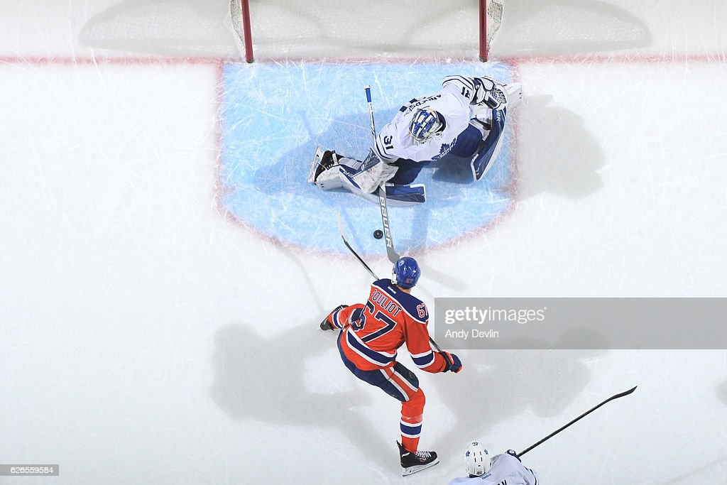 Benoit Pouliot #67 of the Edmonton Oilers takes a shot on Frederik Andersen #31 of the Toronto Maple Leafs on November 29, 2016 at Rogers Place in Edmonton, Alberta, Canada.