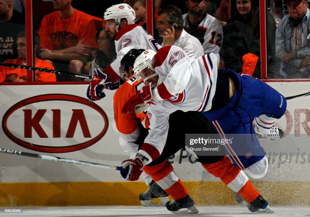 Benoit Pouliot #57 of the Montreal Canadiens gets knocked off his skates against Danny Briere #48 of the Philadelphia Flyers in Game 1 of the Eastern Conference Finals during the 2010 NHL Stanley Cup Playoffs at Wachovia Center on May 16, 2010 in Philadelphia, Pennsylvania.