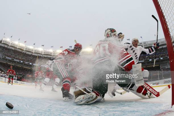 Benoit Pouliot of the New York Rangers celebrates a second period goal against Martin Brodeur of the New Jersey Devils during the 2014 Coors Light...