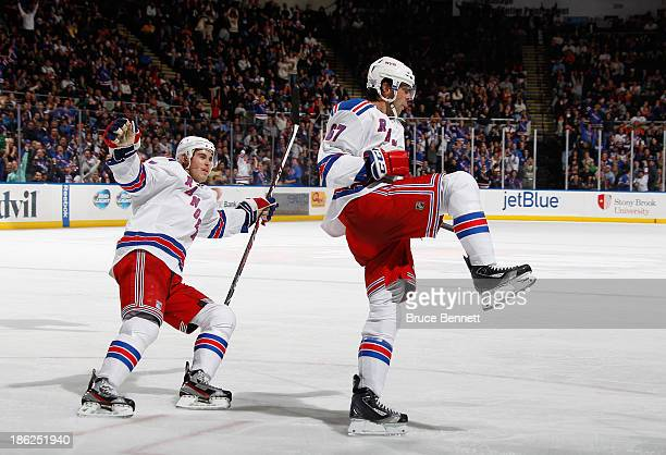 Benoit Pouliot of the New York Rangers celebrates his game winning goal at 1346 of the third period against the New York Islanders at the Nassau...