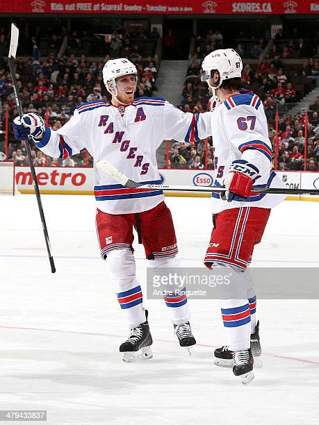Benoit Pouliot of the New York Rangers celebrates his second period goal against the Ottawa Senators with teammate Marc Staal at Canadian Tire Centre...