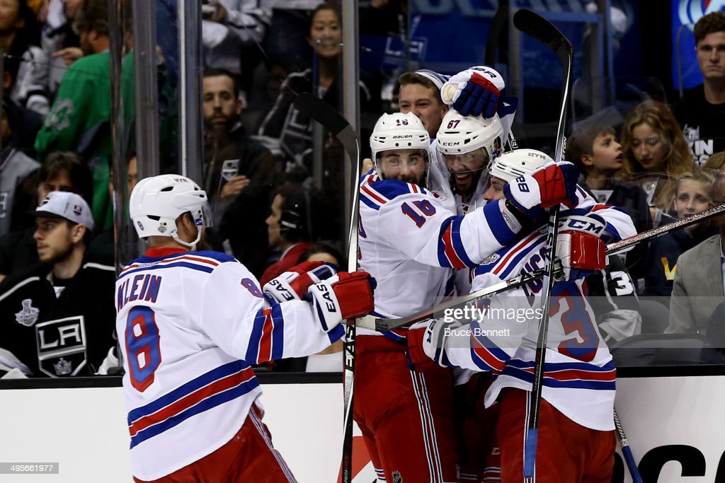 Benoit Pouliot #67 of the New York Rangers celebrates with teammate Derick Brassard #16, Kevin Klein #8, and Mats Zuccarello #36 after Pouliot scores the first goal in the first period against the Los Angeles Kings during Game One of the 2014 NHL Stanley Cup Final at the Staples Center on June 4, 2014 in Los Angeles, California.