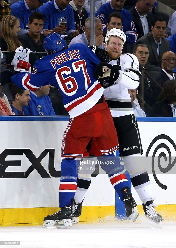 Benoit Pouliot #67 of the New York Rangers checks Jeff Carter #77 of the Los Angeles Kings during the first period of Game Three of the 2014 NHL Stanley Cup Final at Madison Square Garden on June 9, 2014 in New York, New York.