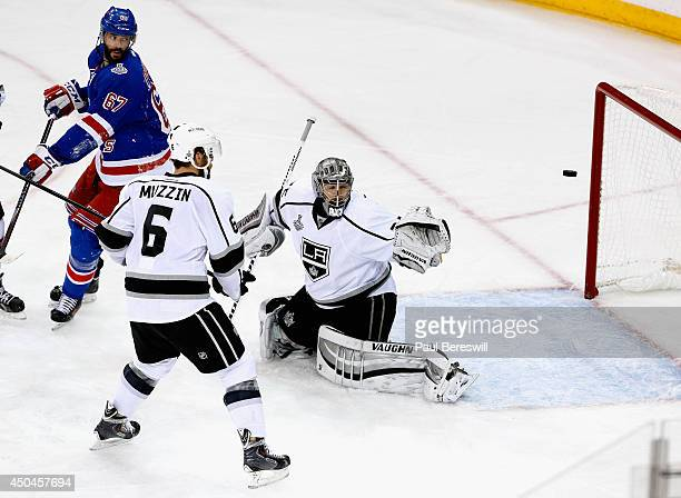 Benoit Pouliot of the New York Rangers scores on Jonathan Quick of the Los Angeles Kings during the first period of Game Four of the 2014 NHL Stanley...
