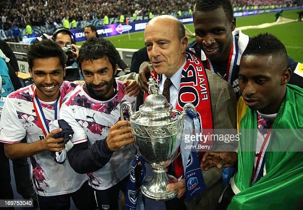Benoit Tremoulinas Fahid Ben Khalfallah Alain Juppe Mayor of Bordeaux holding the trophy Cheick Diabate Andre Biyogo Poko celebrate their 32 victory...