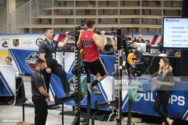BenoitOliver Groulx completes the pull ups test during the NHL Scouting Combine on June 2 2018 at HarborCenter in Buffalo New York