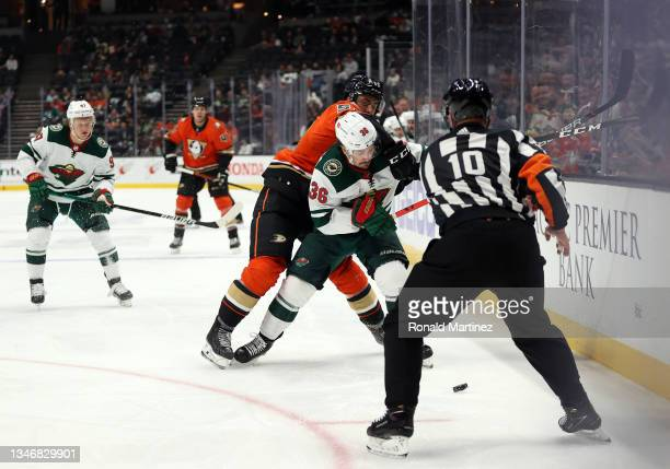 Benoit-Olivier Groulx of the Anaheim Ducks skates against Mats Zuccarello of the Minnesota Wild in the first period at Honda Center on October 15,...