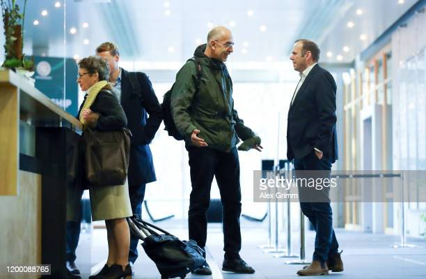 Benrd Hoffmann, CEO of Hamburger SV, and Sven Brux, Head of Security FC St. Pauli, chat prior to a DFB Sports Court appeal of Hamburger SV and FC St....