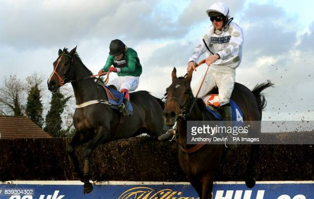 Bensalem ridden by Robert Thornton overtakes Chariot Charger ridden by Jack Doyle and goes on to win the Annington Kandahar Novice's Steeple Chaseat...