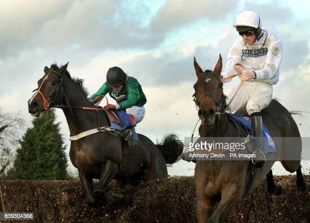 Bensalem ridden by Robert Thornton overtakes Chariot Charger ridden by Jack Doyle and goes on to win the Annington Kandahar Novice's Steeple Chase at...