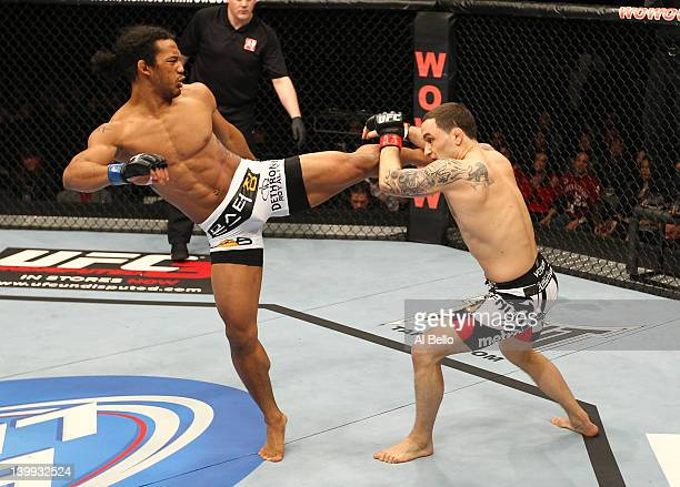 Benson Henderson kicks Frankie Edgar during the UFC 144 event at Saitama Super Arena on February 26, 2012 in Saitama, Japan.