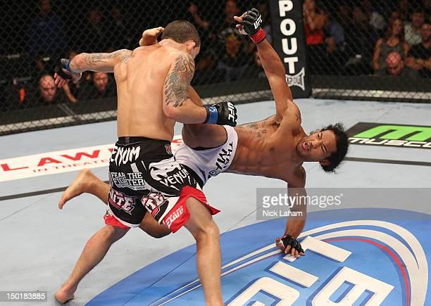 Benson Henderson kicks Frankie Edgar during their lightweight championship bout at UFC 150 inside Pepsi Center on August 11, 2012 in Denver, Colorado.