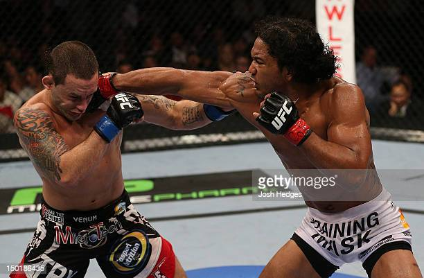 Benson Henderson punches Frankie Edgar during their lightweight championship bout at UFC 150 inside Pepsi Center on August 11 2012 in Denver Colorado