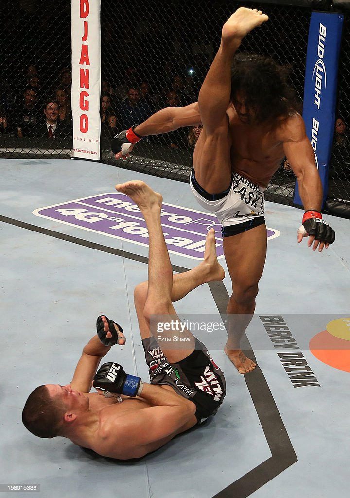 Benson Henderson (white shorts) readies a kick towards Nate Diaz during their lightweight championship bout at the UFC on FOX event on December 8, 2012 at Key Arena in Seattle, Washington.