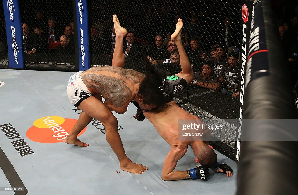 Benson Henderson (left) slams Nate Diaz (right) during their lightweight championship bout at the UFC on FOX event on December 8, 2012 at Key Arena in Seattle, Washington.