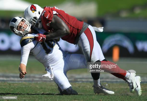Benson Mayowa of the Arizona Cardinals hits quarterback Jared Goff of the Los Angeles Rams, who was called for intentional grounding at Los Angeles...