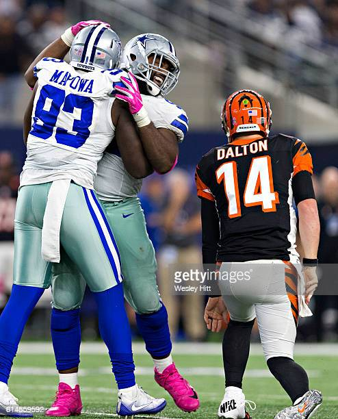 Benson Mayowa of the Dallas Cowboys celebrates with a teammate after sacking quarterback Andy Dalton of the Cincinnati Bengals at AT&T Stadium on...