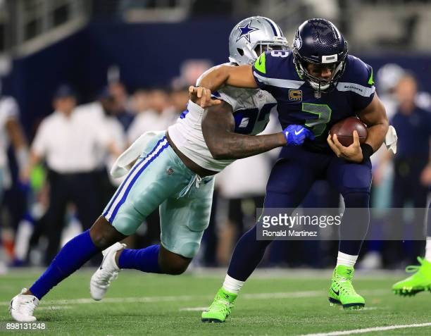 Benson Mayowa of the Dallas Cowboys sacks Russell Wilson of the Seattle Seahawks in the third quarter of a football game at AT&T Stadium on December...