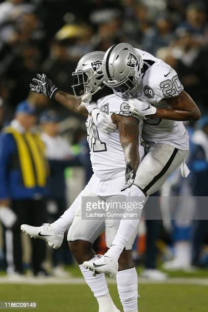 Benson Mayowa of the Oakland Raiders celebrates with Daryl Worley after sacking quarterback Philip Rivers of the Los Angeles Chargers in the first...