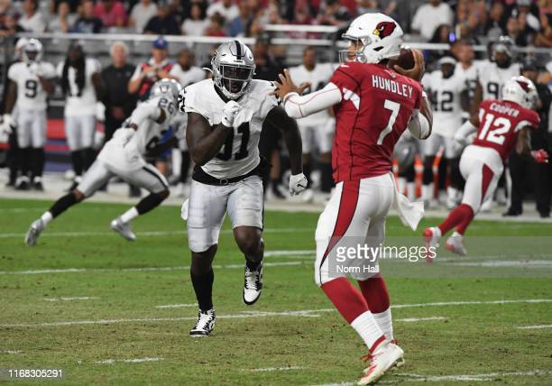 Benson Mayowa of the Oakland Raiders rushes in on Brett Hundley of the Arizona Cardinals during the second quarter of an NFL preseason game at State...
