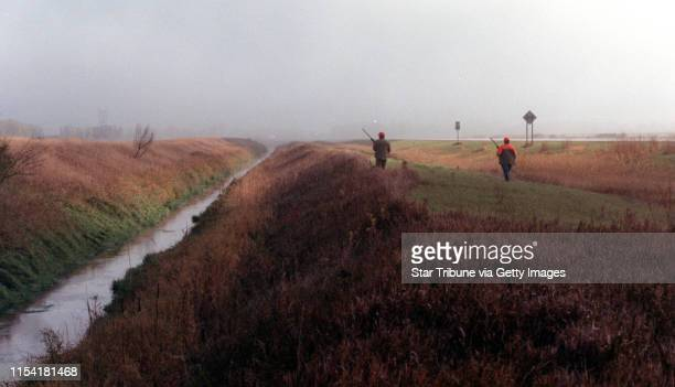 Benson Mn Sat Oct 13 2001Fog envelops hunters as the 2001 Minnesota pheasant season opens IN THIS PHOTO Through the wet grass and early mist Scott...