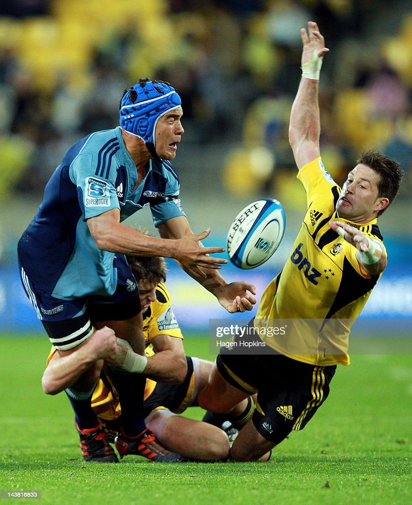 Benson Stanley of the Blues is tackled by Beauden Barrett of the Hurricanes while Cory Jane attempts an intercept during the round 11 Super Rugby match between the Hurricanes and the Blues at Westpac Stadium on May 4, 2012 in Wellington, New Zealand.