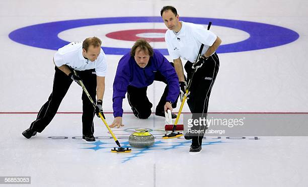 Bent Aanund Ramsfjell, Paal Trulsen and Flemming Davanger of Norway compete in the preliminary round of the men's curling between Sweden and Norway...